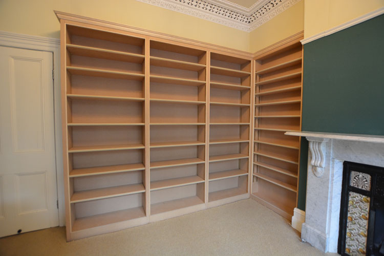 Hand built corner library wall