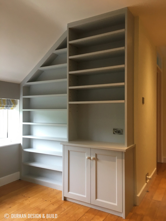 Landing shelving with slanting ceiling